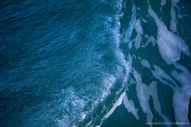 Looking down on a wave from the pier in Pacifica, CA.